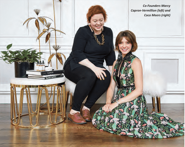 two women CEOs seated for picture