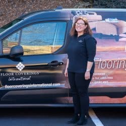 Kris Piotrowski stands outside in front of her work vehicle