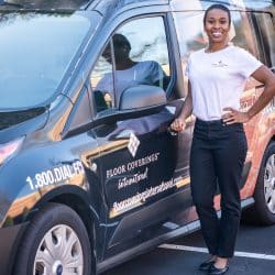 Shadia Gooden poses outside in front of her work vehicle