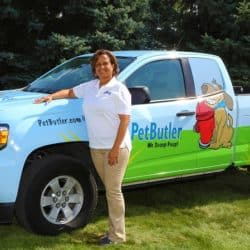 Rebecca Stewart stands outside in front of her Pet Butler work vehicle