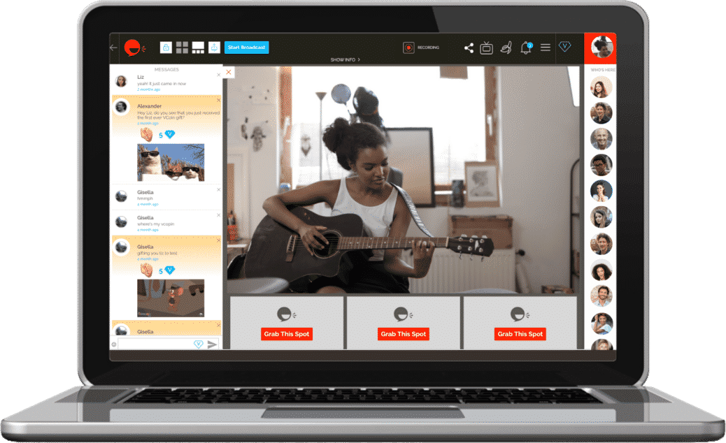 young black woman filming a video while playing guitar