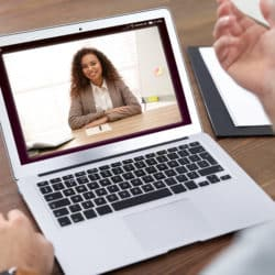 woman using video chat for online job interview in office, closeup