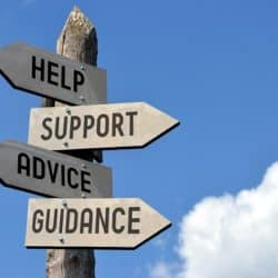 "A collection of signs reading ""help"", ""support"", ""advice"", and ""Guidance"""