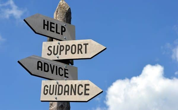 """A collection of signs reading """"help"""", """"support"""", """"advice"""", and """"Guidance"""""""