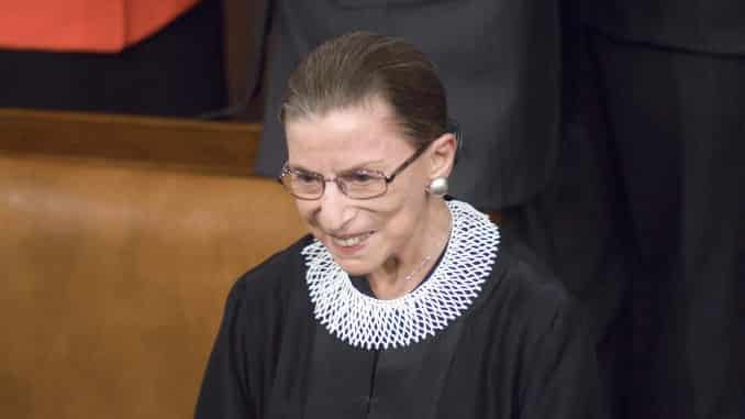 Ruth Bader Ginsberg smiling wearing the supreme court justice robe