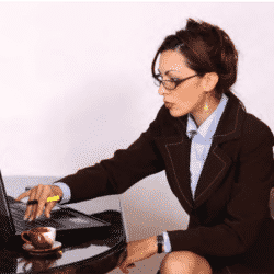 professional woman working from during pandemic on her latop