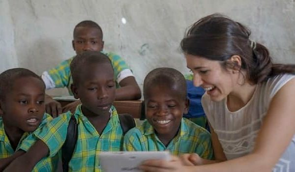 woman working with children working in one her nonprofits nonprofit
