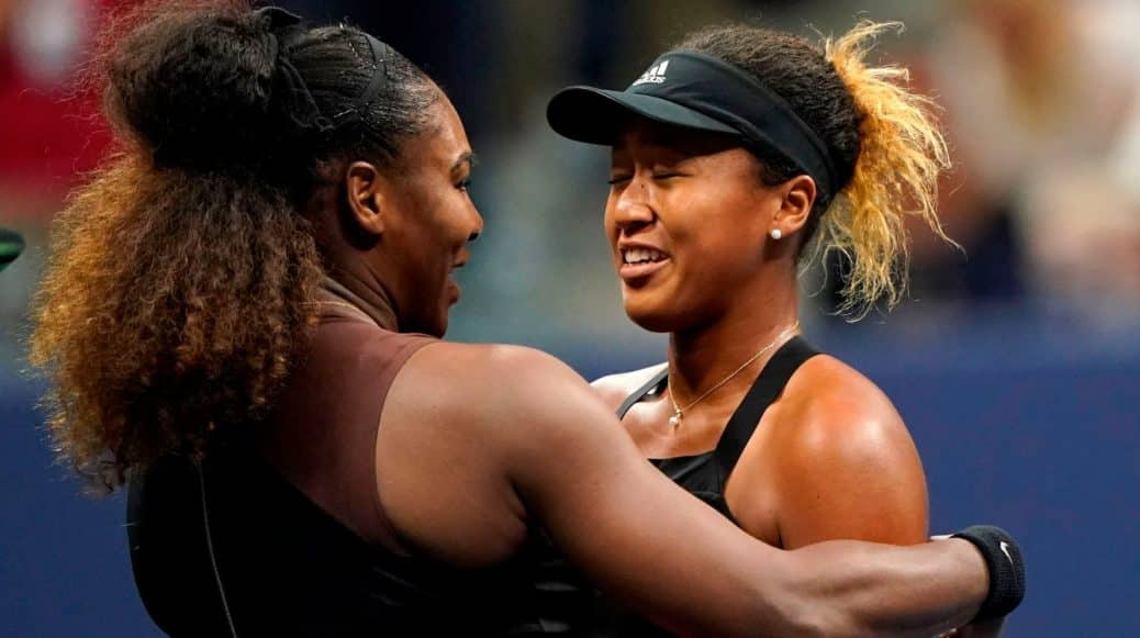 Serena Williams and Naomi Osaka hugging after a tennis match