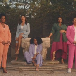 Image of black business women wearing colorful suits
