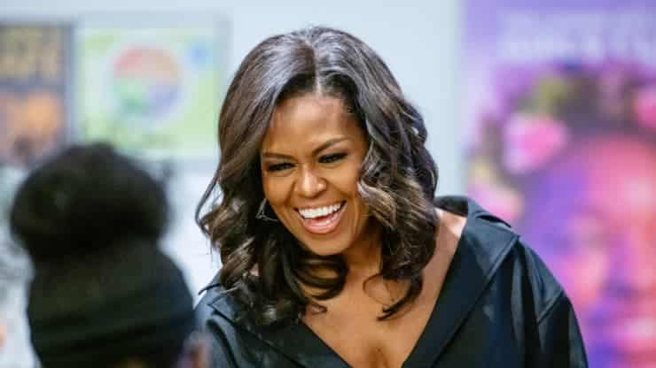 Michelle Obama smiling wearing black for netflix