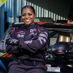 Brehanna Daniels wearing a NASCAR uniform while seated on a NASCAR vehicle