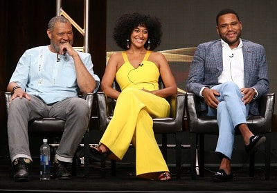 Laurence Fishburne, Tracee Ellis Ross and Anthony Anderson speaking as a panel onstage