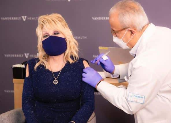 Dolly Parton getting the moderna covid-19 vaccine from physician.