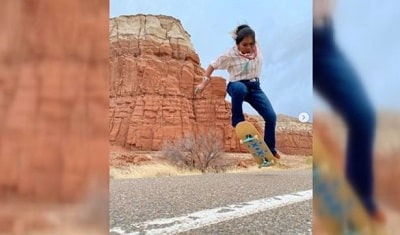 Naiomi Glass is doing a trick on her skateboard in Arizona