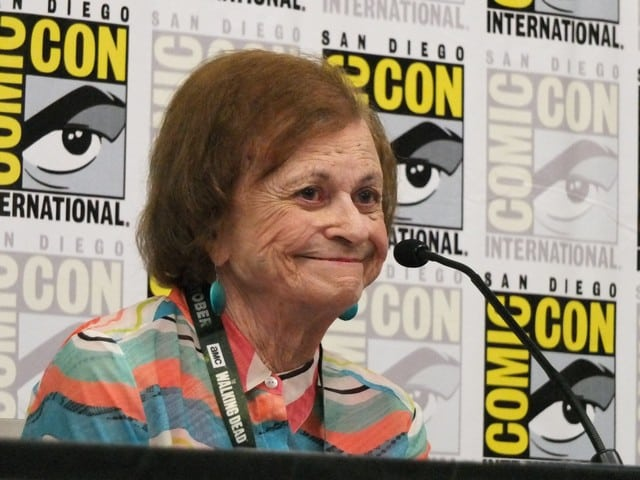 Joye Hummel at a comic-con convention speaking on a pannel.