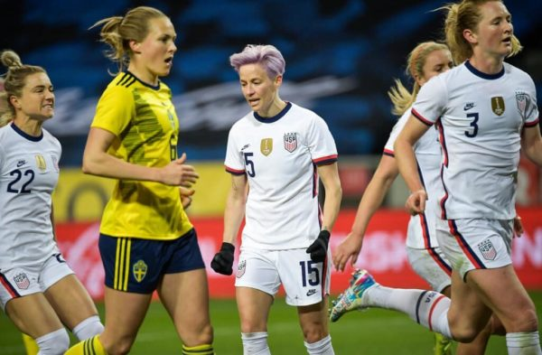 Megan Rapinoe at the U.S. versus Sweden match with teammates on the field