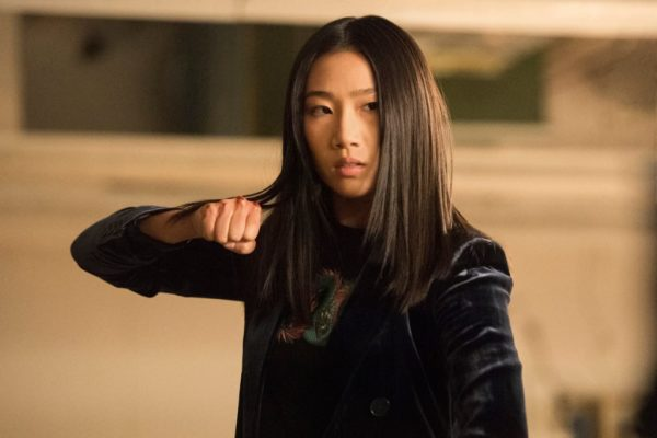 "Olivia Liang as Nicky in ""Kung Fu"" holding a fist up ready to fight kung fu"