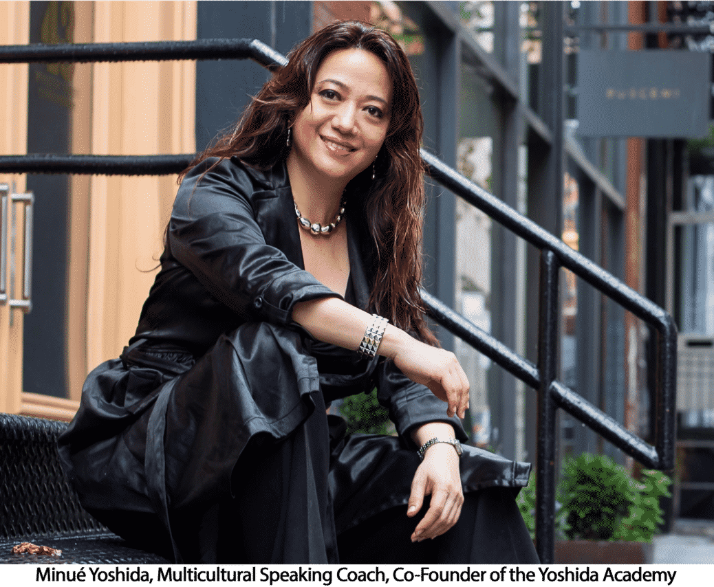 Woman in black jacket and pants smiling sitting on stairs