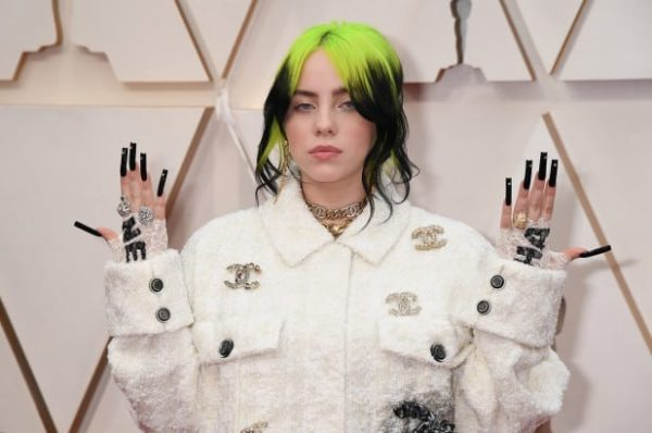 Billie Eilish strikes a pose at the 2020 Oscars in an all Chanel outfit