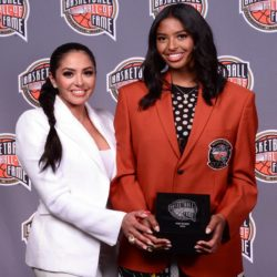 Vanessa and Natalia Bryant holding Kobe Bryants Hall of fame trophy in business suits