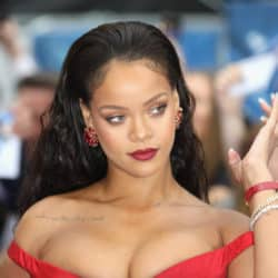 Rihanna wearing a red dress and red lipstick
