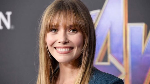 Elizabeth Olsen pictured smiling away from the camera